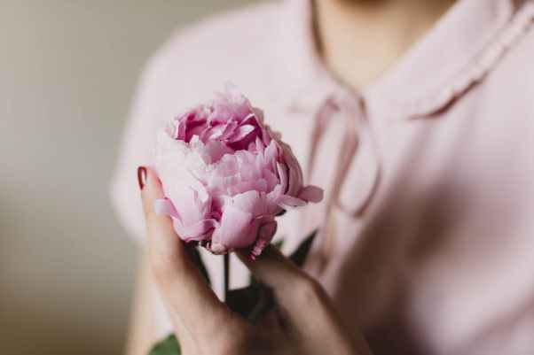 lady with pink flower
